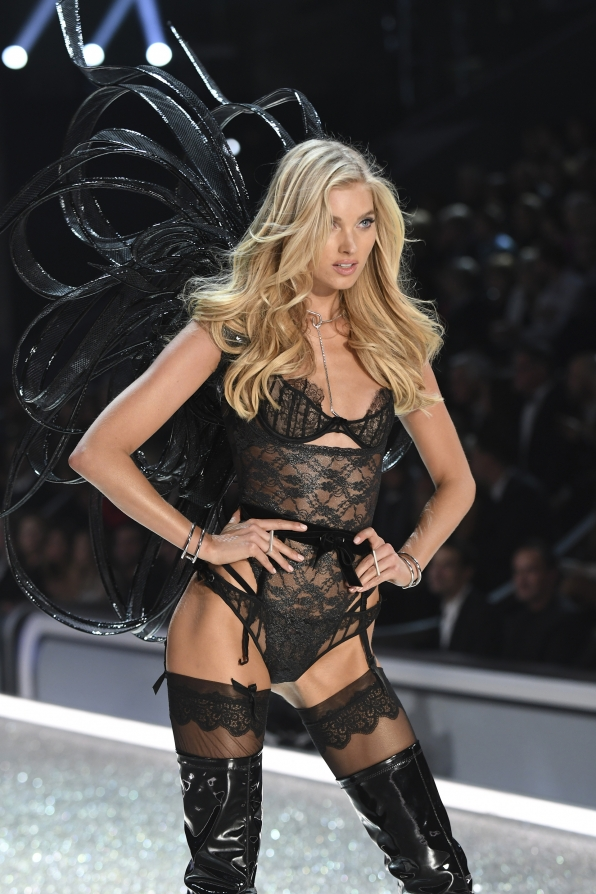 Elsa Hosk is quite the provocative operative in barely-there lingerie, thigh-high boots, and large black wings.