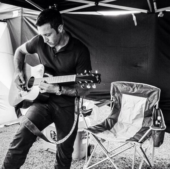 Hawaii Five-0 Instagram: Alex showing off his guitar skills in the cast tent #CBSInstagramTakeover @rachelcerettophotography