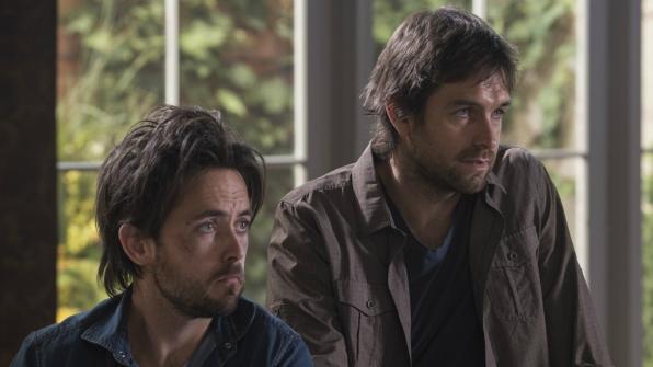 Cam and Garrett listen intently.