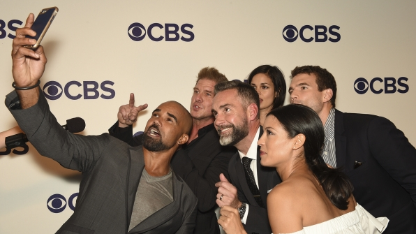 The cast of S.W.A.T. takes a selfie on the red carpet.