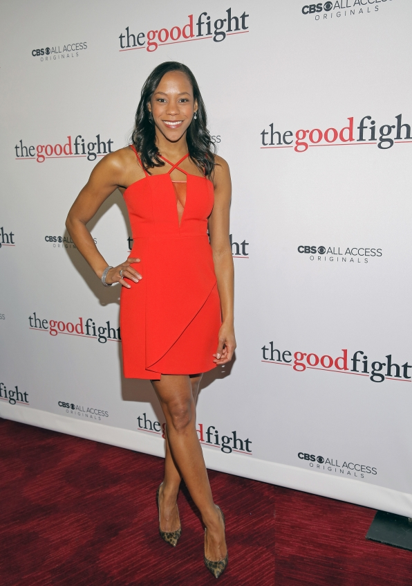 Nikki M. James looks ravishing in a strappy, red dress.