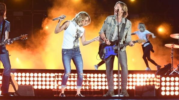 Carrie Underwood and Keith Urban light up center stage with lots of style.
