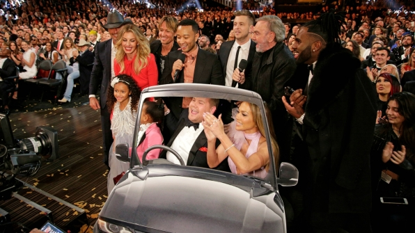 "James Corden took a bevy of stars for a cardboard ride in an impromptu singalong of Carpool Karaoke of ""Sweet Caroline."""