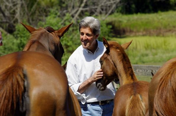 13. John Kerry Pets Horses
