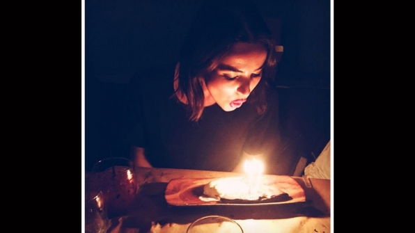 Make a wish! Ashleigh Brewer blows out the candles of her birthday cake.