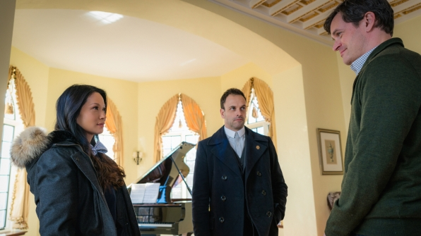 Lucy Liu as Joan Watson, Jonny Lee Miller as Sherlock Holmes, and Tom Everett Scott as Henry Baskerville