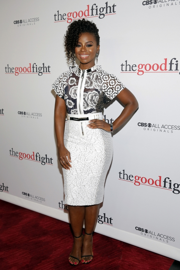 Erica Tazel combines black strappy heels with a white pencil skirt to keep all eyes on her elaborate—and elegant—top.