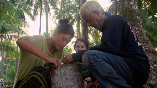 Michele and Joe try to start a fire as Aubry watches on.