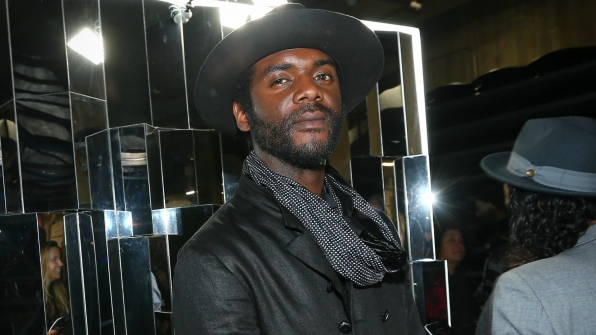Gary Clark Jr. grabs a pensive moment backstage at Staples Center.