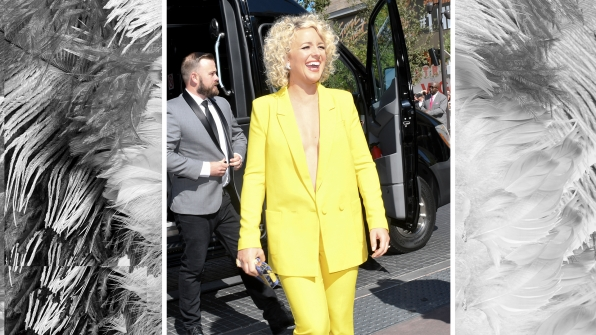 Cam is a ray of sunshine in a canary yellow two-piece suit.