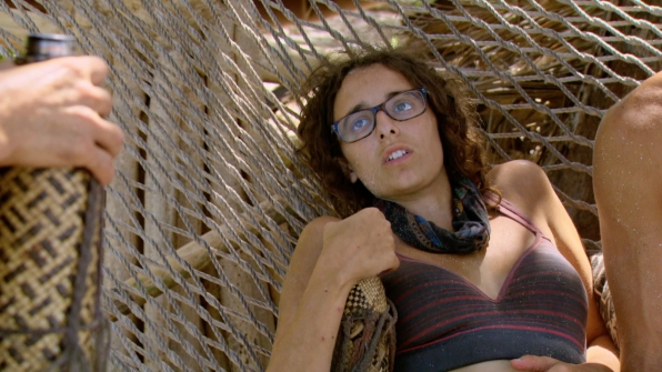 Hannah, the last woman standing this season, relaxes on a hammock.