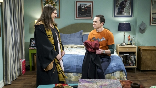 Amy gives Sheldon his own robe.