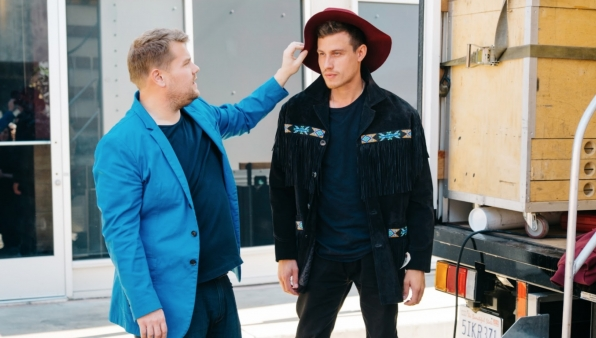 James even helps with wardrobe, finding this gentleman the perfect hat for his character.