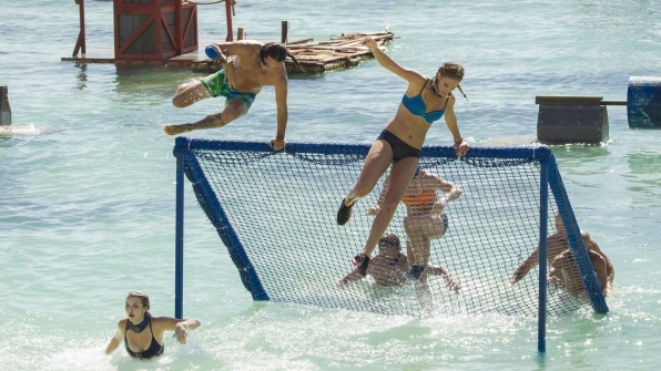 The obstacle course sends castaways flying high over nets.
