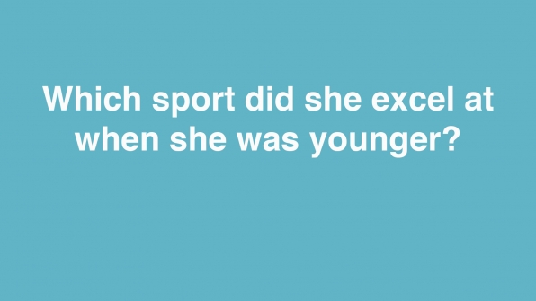 Which sport did she excel at when she was younger?