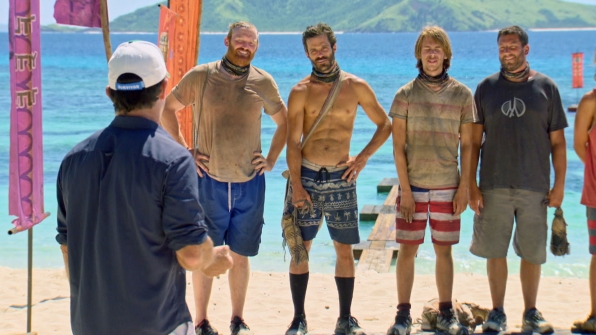 Jeff Probst looks out toward Chris, Ken, Will, and Bret.