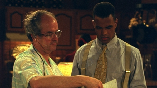 Kristoff St. John looks dapper in beige suspenders.