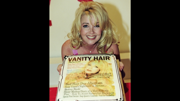 Melody Thomas Scott poses with her congratulatory cake honoring 25 years of Nikki Newman.
