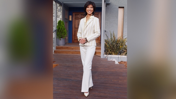 Here, Julie rocked a cream and white striped pantsuit.
