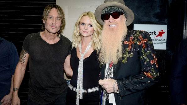 "Keith Urban, Miranda Lambert, and ZZ Top guitarist Billy Gibbons hugged backstage before performing ""Tush."""