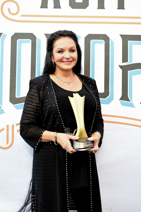 Crystal Gayle makes an entrance impossible to forget.