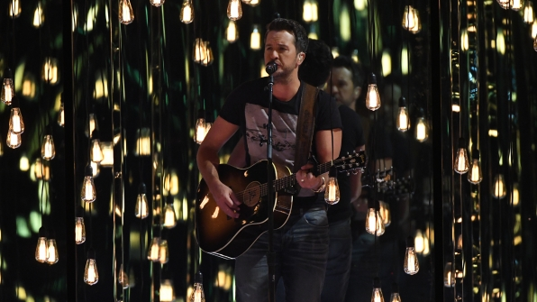 "Luke Bryan performs ""Fast"" at the 52nd ACM Awards"