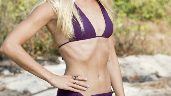 "With abs like these, it's no wonder this Texas beauty's in the ""Braun Tribe."""