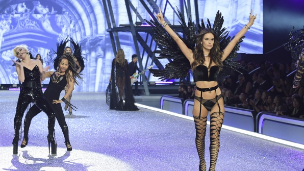 Angel Alessandra Ambrosio slithers down the runway dressed as a velvet vixen.