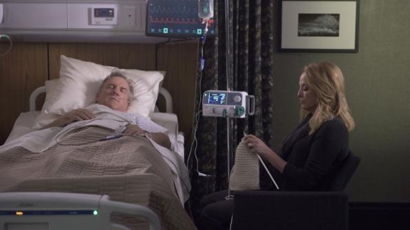 Madeline Hawthorne sits by her husband's bedside.