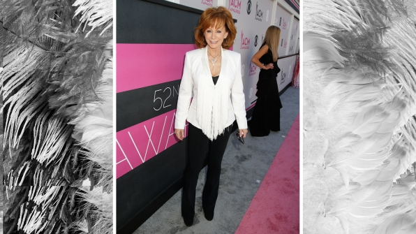 "Reba McEntire is ""Fancy"" in white fringe blazer with black dress slacks."