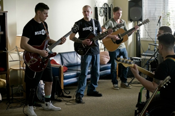 The band featured in the episode is the real MusiCorps Wounded Warrior Band.