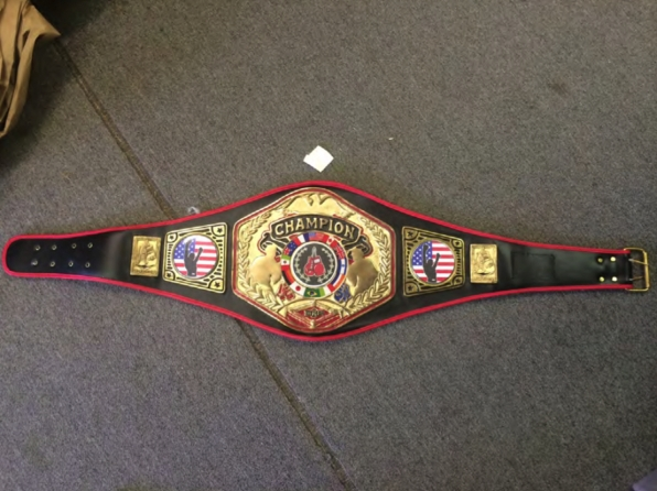 The championship belt featured flags from 12 countries.