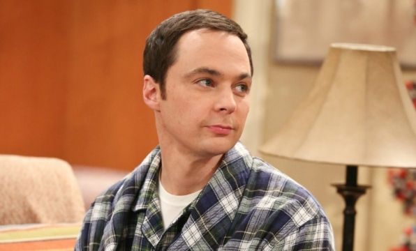 Sheldon smiles at Leonard during the morning quiz.