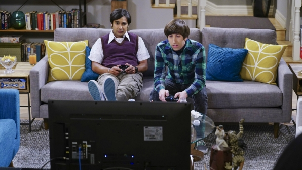Howard and Raj pass the time by playing video games.