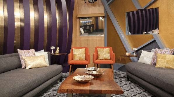 The new color palette for the living room is purple, gold, and orange.