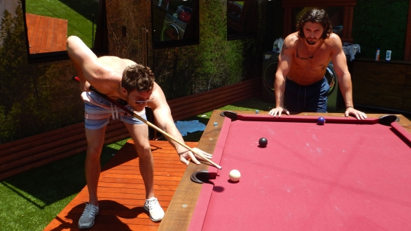 Corey and Victor cue up for a game of pool.