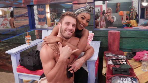 Paulie manages to Hang 10 while Zakiyah gives him a hug.