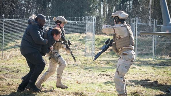 Abraham Kenyatta carries Mitch Morgan to safety.