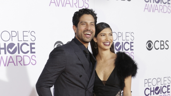 Criminal Minds' Adam Rodriguez donned all black with his wife on the People's Choice Awards red carpet.