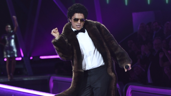 Bruno Mars dances the night away.