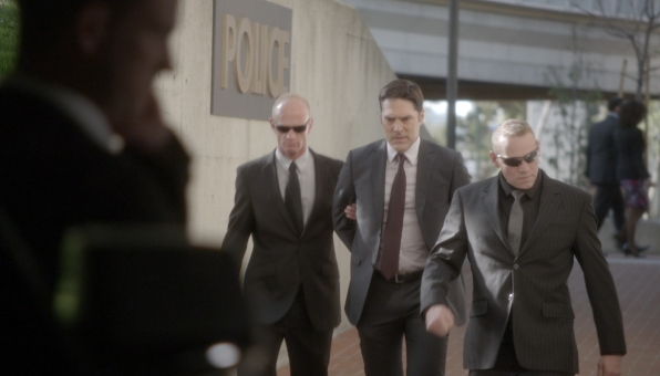 Hotch is led away for questioning.