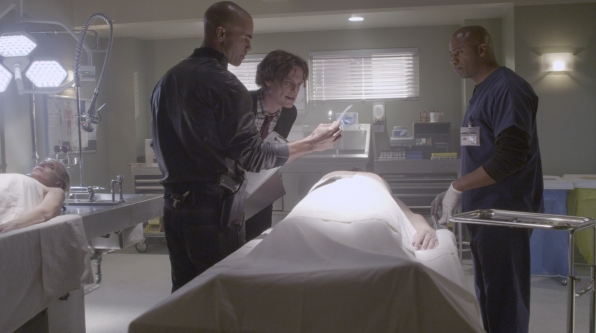 Derek and Reid take a look at the victim.