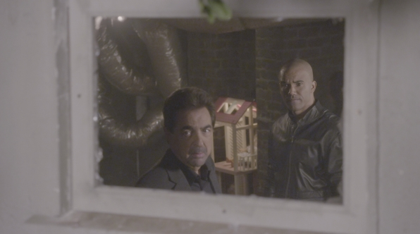 Rossi and Derek investigate the scene.