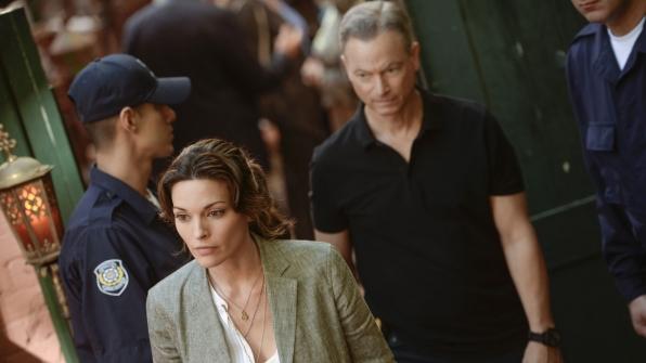 Clara Seger and Jack Garrett explore the crime scene.