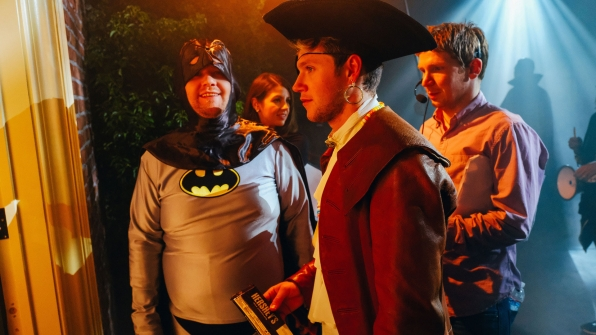 James looked tickled behind the scenes of their Halloween music video shoot.