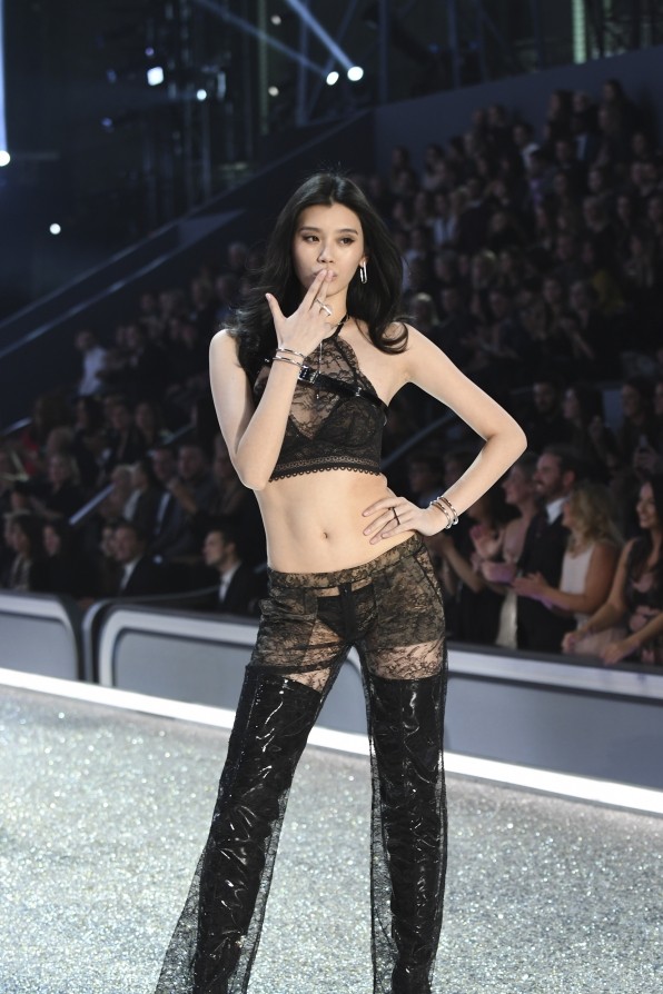 Ming Xi is one groovy undercover agent in this lacy black ensemble.