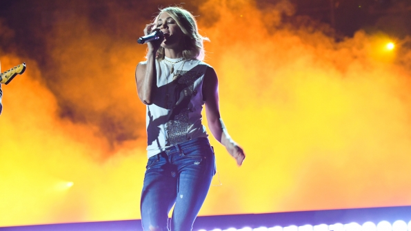 Carrie Underwood glows all on her own as she sings on stage.