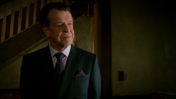 John Noble as Mr. Morland Holmes