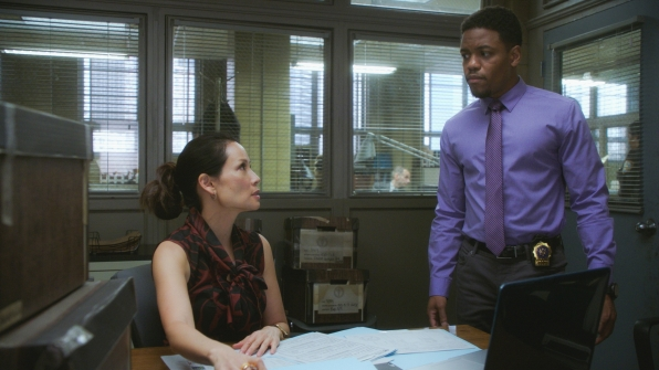 Lucy Liu as Dr. Joan Watson and Jon Michael Hill as Detective Marcus Bell