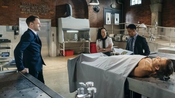 Jonny Lee Miller as Sherlock Holmes, Lucy Liu as Dr. Joan Watson, and Jon Michael Hill as Det. Marcus Bell
